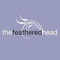 The Feathered Head Logo