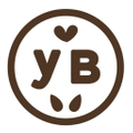 Yumbutter // World Changing Nut Butters Logo